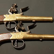 Pair Queen Anne style, flintlock pocket pistols by J&W Richards
