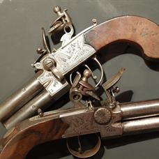 Pair double-barrelled flintlock pocket pistols by Adams, London